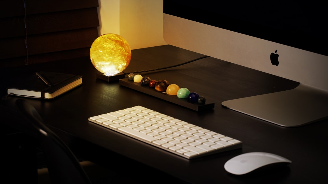 Light Up Your Life—and Desk—With This Sun-Shaped Mood Lamp and Gemstone Planet Set