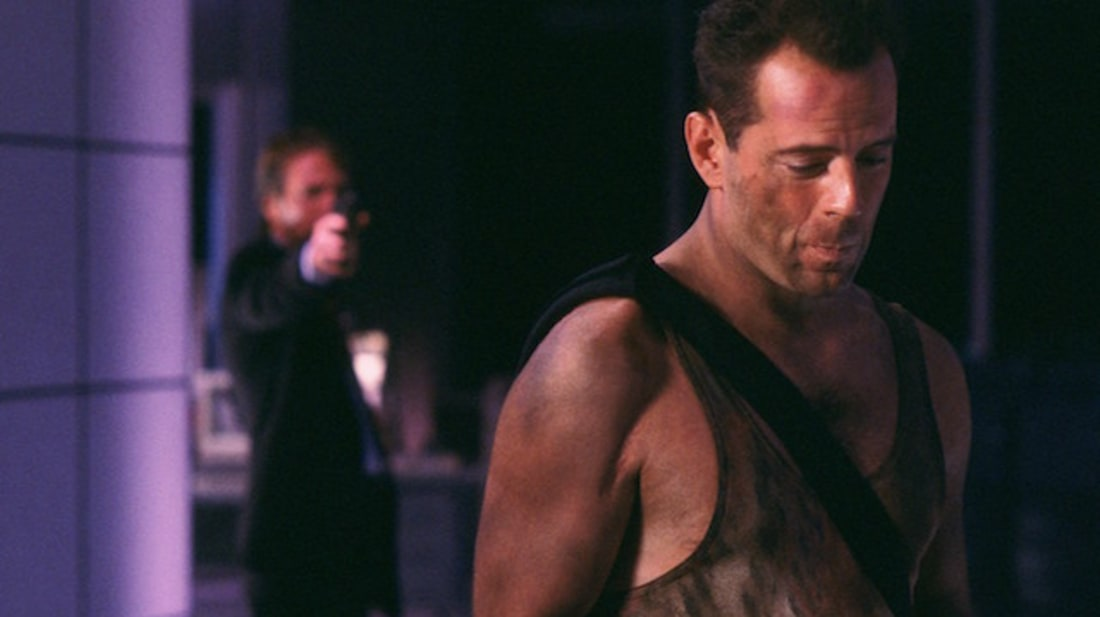 Alan Rickman and Bruce Willis in Die Hard (1988).