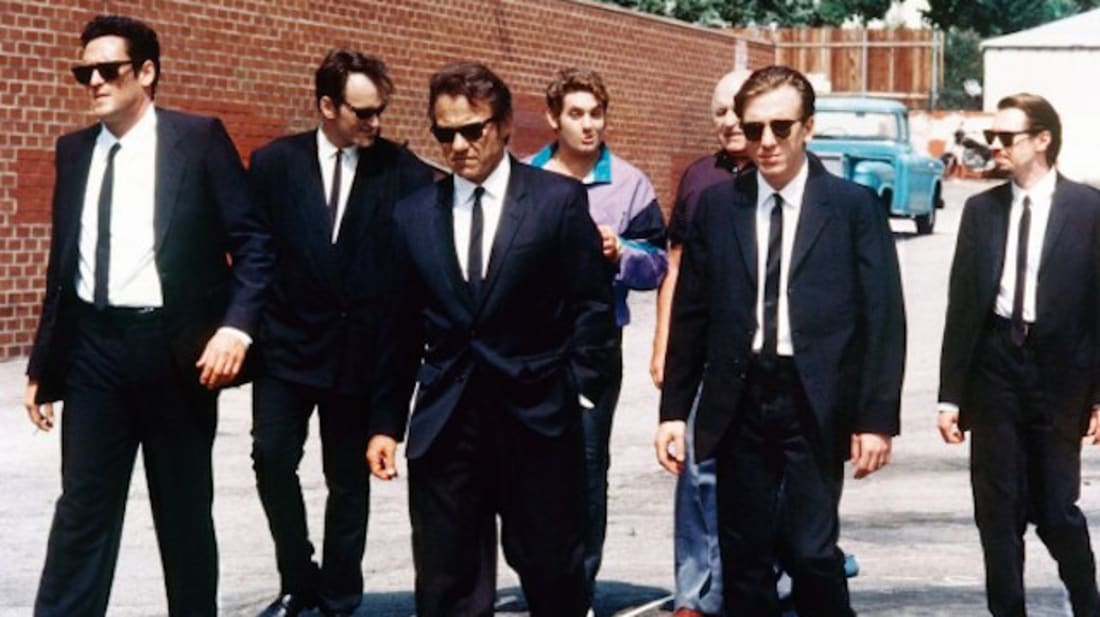 Steve Buscemi, Harvey Keitel, Quentin Tarantino, Michael Madsen, Tim Roth, Chris Penn, Edward Bunker, and Lawrence Tierney in Reservoir Dogs (1992).