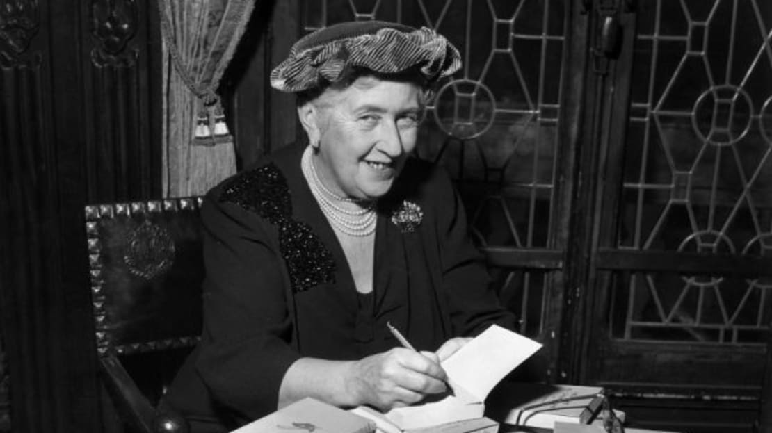 British mystery author Agatha Christie autographing French editions of her books in 1950.