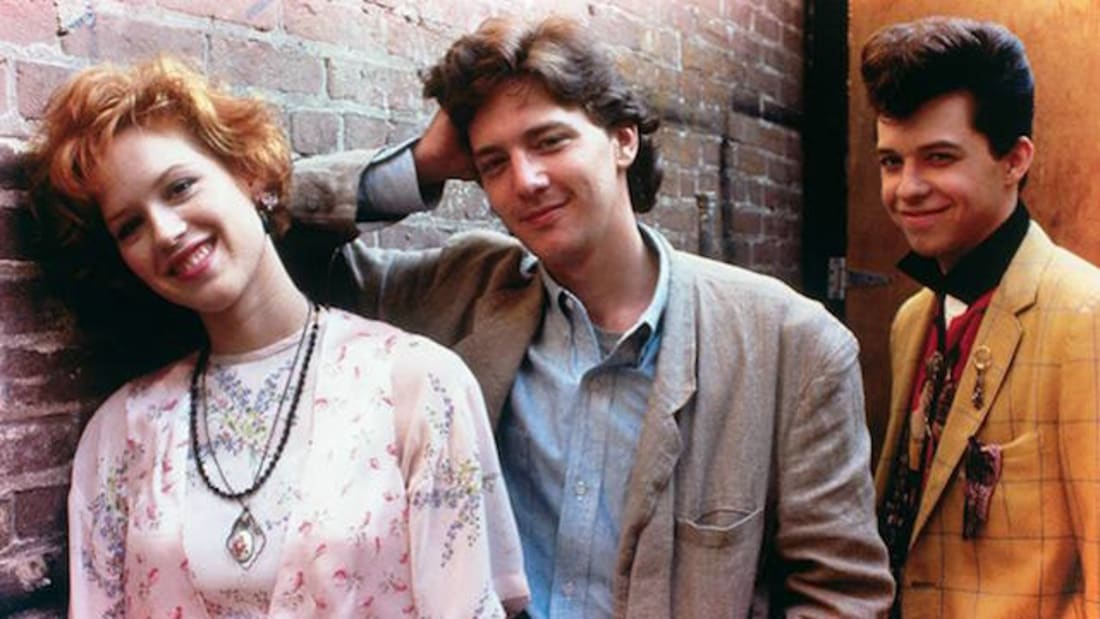 Molly Ringwald, Andrew McCarthy, and Jon Cryer in Pretty in Pink (1986).
