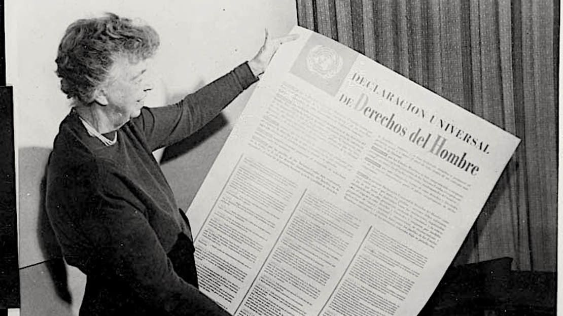 Eleanor Roosevelt holds a Spanish-language version of the UN Declaration of Human Rights.