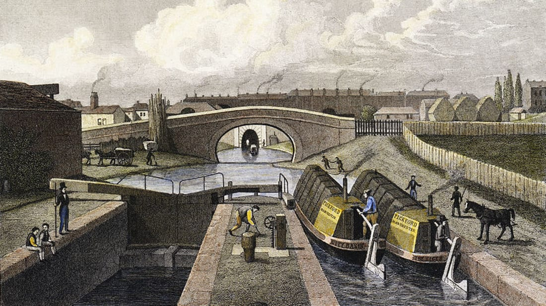 """Frederick James Havell's painting, """"The Double Lock and East Entrance to the Islington Tunnel, Regent's Canal"""" (1827), shows two horse-drawn canal boats passing through the lock, approaching the tunnel. Construction of the Regent's Canal began in 1812."""