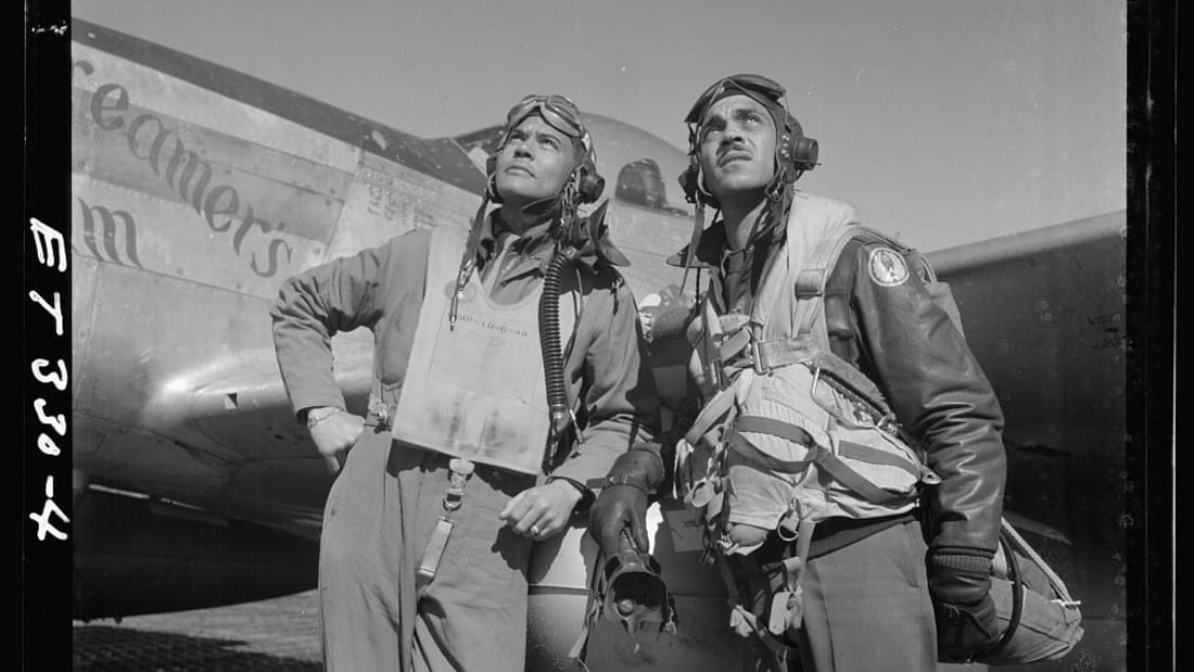 Col. Benjamin O. Davis (left), commanding officer of the 332nd Fighter Group, and Edward C. Gleed, group operations officer, stand in front of a plane in Ramitelli, Italy, in March 1945.