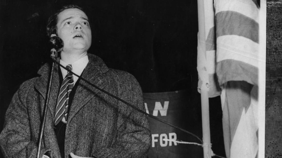 Orson Welles at a demonstration in New York City