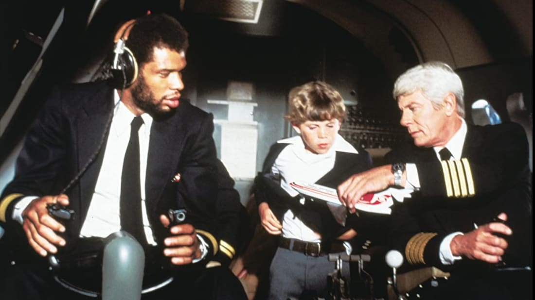 Kareem Abdul-Jabbar, Rossie Harris, and Peter Graves in Airplane! (1980).