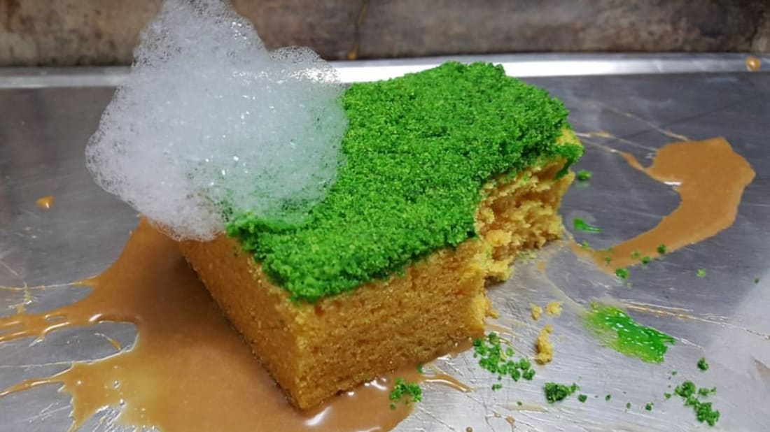 Olive oil sponge cake with mint crumb, sweet milk foam, and a baked apple puree.