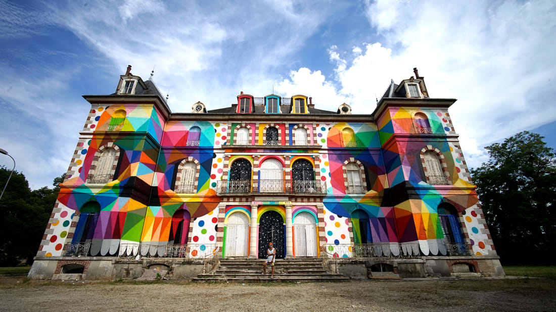 A French chateau, painted by Spanish graffiti artist Okuda San Miguel to promote French street art festival LaBel Valette Festival.