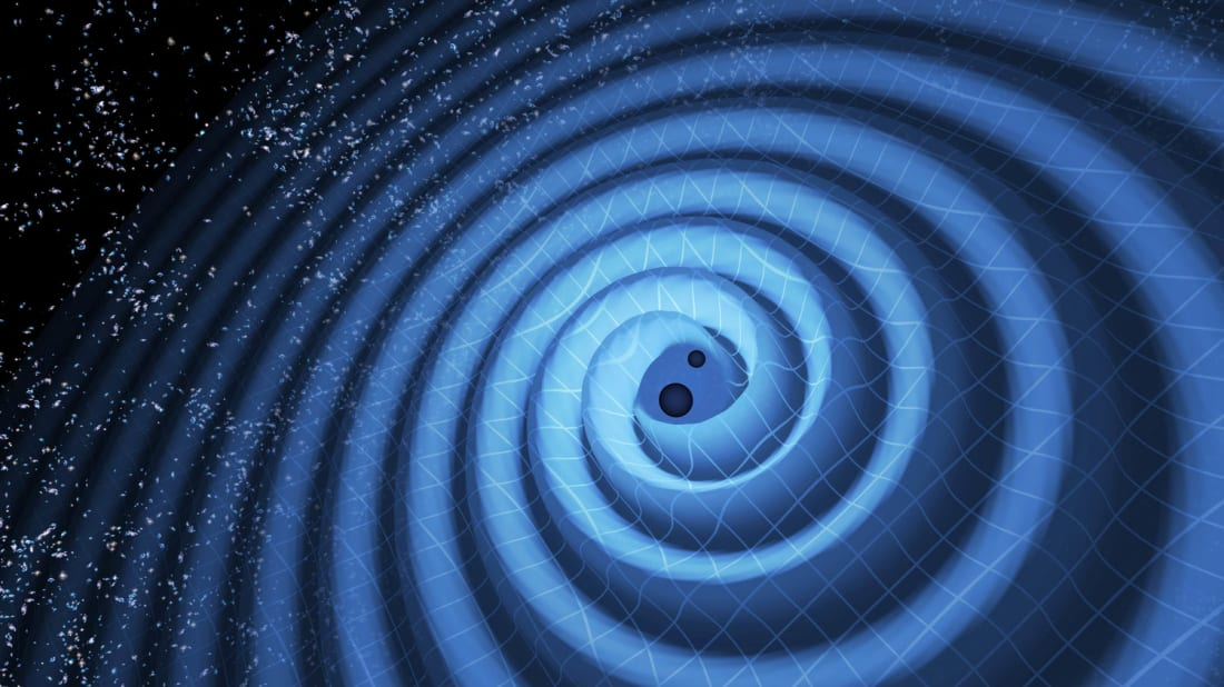 An illustration showing the merger of two black holes and the gravitational waves that ripple outward as the black holes spiral toward each other.