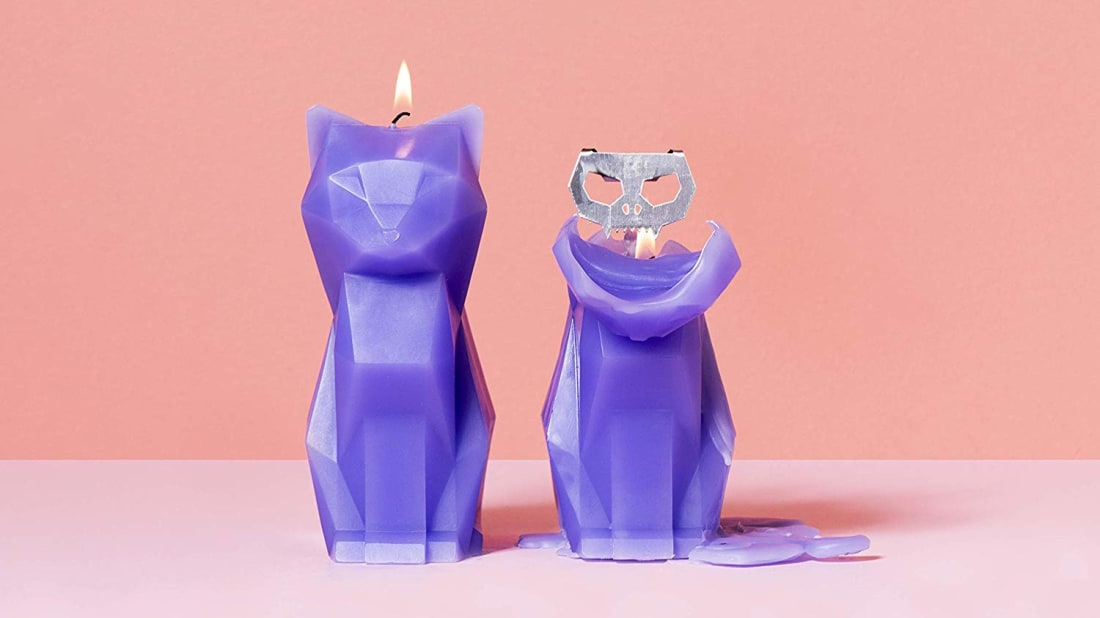 Two purple PyroPet candles, one in the process of burning down