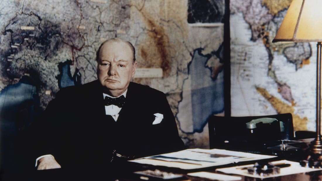 The Prime Minister seated at his desk in the No 10 Annexe Map Room, May 1945.
