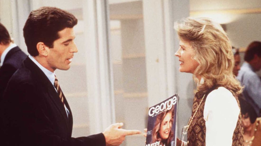 Guest star John F. Kennedy Jr. and Candice Bergen on Murphy Brown (1995).