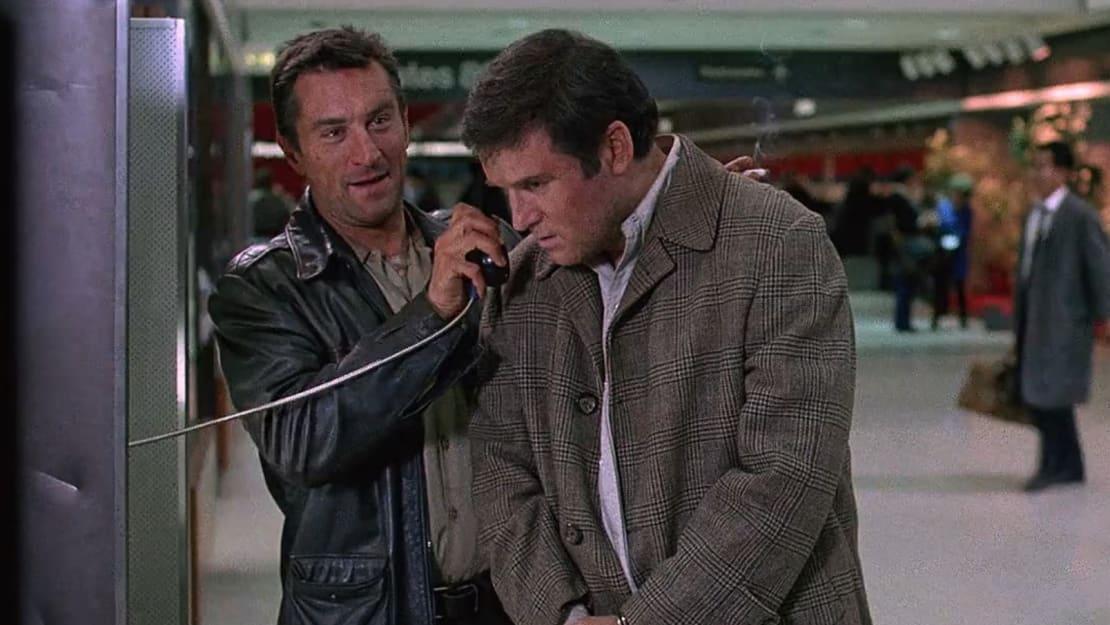 Robert De Niro and Charles Grodin star in Midnight Run (1988).