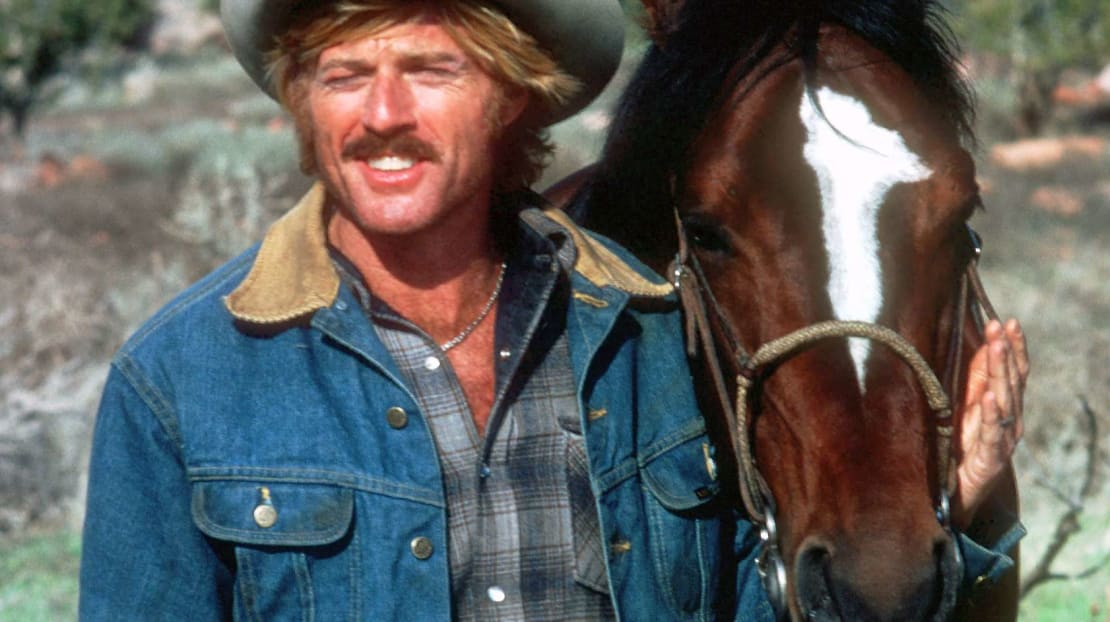 Robert Redford and his horse Let's Merge on the set of The Electric Horseman (1979).