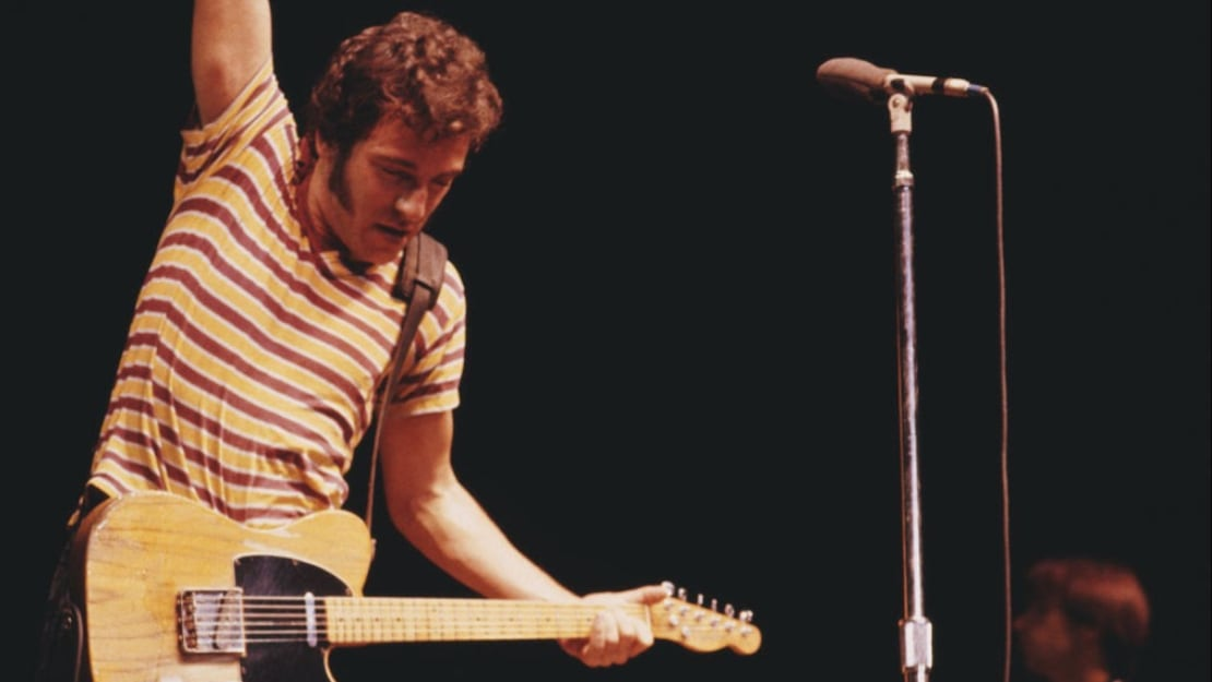 Bruce Springsteen performs on stage.