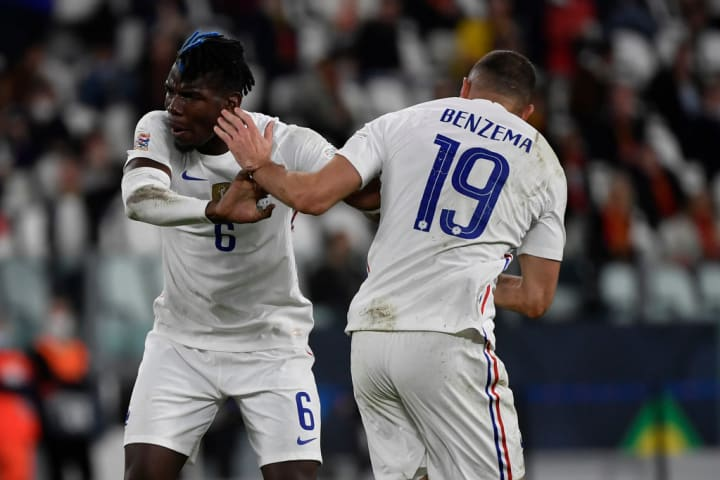 Karim Benzema of France (r) celebrates with Paul Pogba after ...