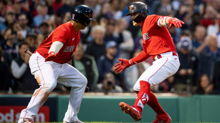 Enrique Hernandez and Rafael Devers celebrate the success of the Red Sox
