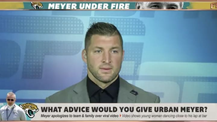 Tim Tebow reacting to the Urban Meyer news.