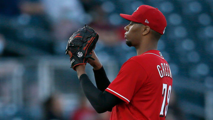 Cincinnati Reds starting pitcher Hunter Greene (79) waits for a signal in the first inning of the