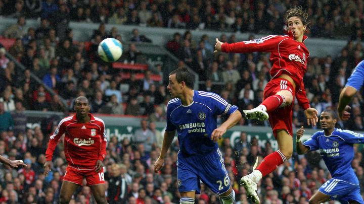 Fernando Torres (2nd R) of Liverpool hea