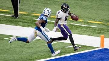 Lamar Jackson (8) of the Baltimore Ravens runs in for a second half touchdown against the Indianapolis Colts.
