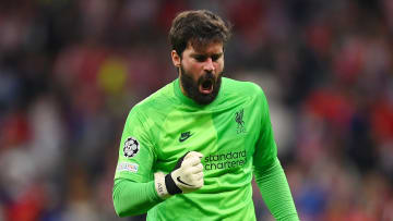 Alisson celebrates the Liverpool victory