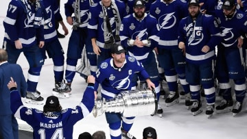 Tampa Bay Lightning center Steven Stamkos (91) hoists the Stanley Cup after the Lightning defeated the Montreal Canadiens.