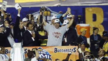 SAN DIEGO - JANUARY 26:  Head coach Jon Gruden of the Tampa Bay Buccaneers holds the Lombardi Trophy