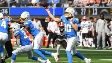 Chargers quarterback Justin Herbert (10) throws a pass against the Cleveland Browns in the second half at SoFi Stadium.