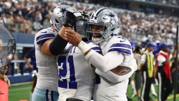 Cowboys running back Ezekiel Elliott (21) celebrates a third quarter touchdown with quarterback Dak Prescott (4) against the New York Giants.