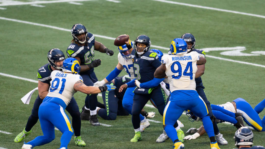 Seahawks QB Russell Wilson looks to make a play during a game against the Rams last season.