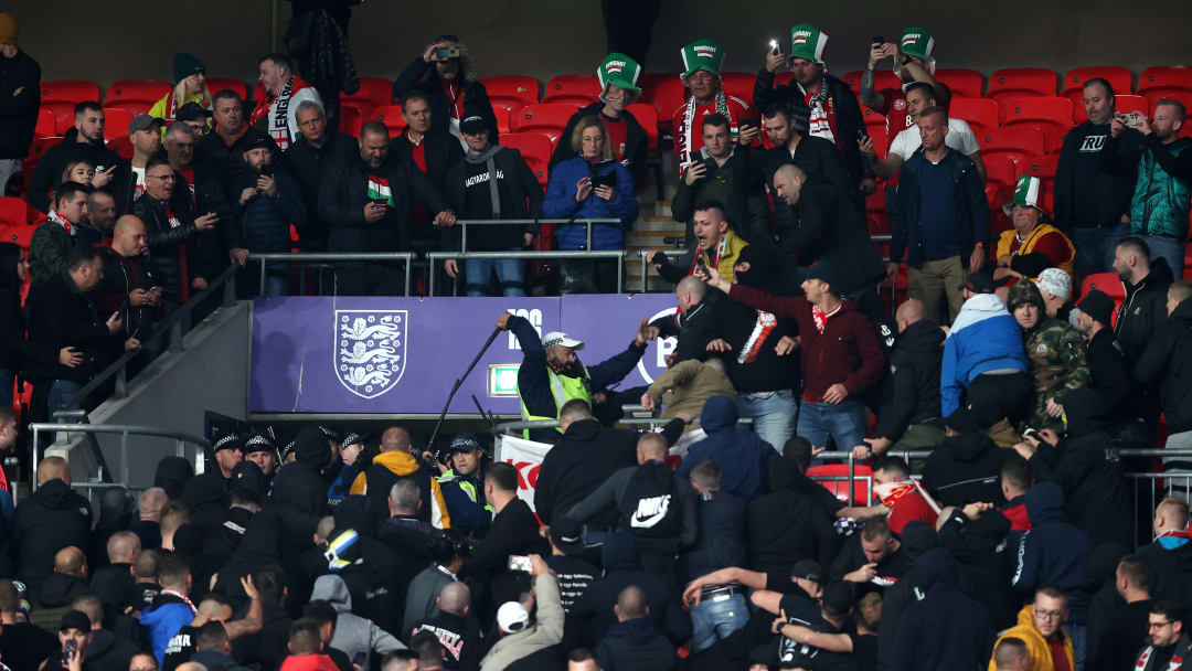 Fans and police clash in the stands