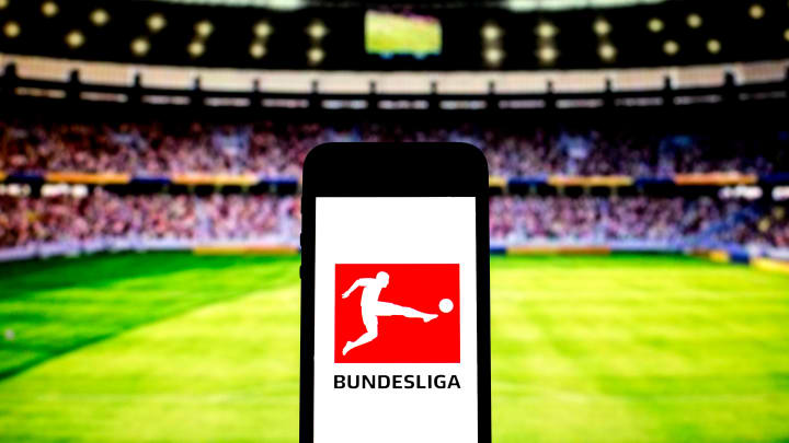In this photo illustration a Bundesliga logo seen displayed...