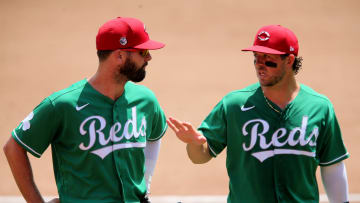 Cincinnati Reds left fielder Jesse Winker (33) and Cincinnati Reds second baseman Kyle Farmer