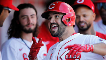 Cincinnati Reds third baseman Eugenio Suarez (7) celebrates with his teammates after hitting a solo