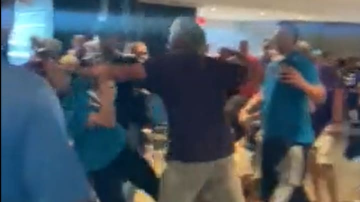 Vikings and Panthers fans brawl in the concourse at Bank of America Stadium.