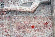 Kisses and graffiti left at Oscar Wilde's tomb in Paris
