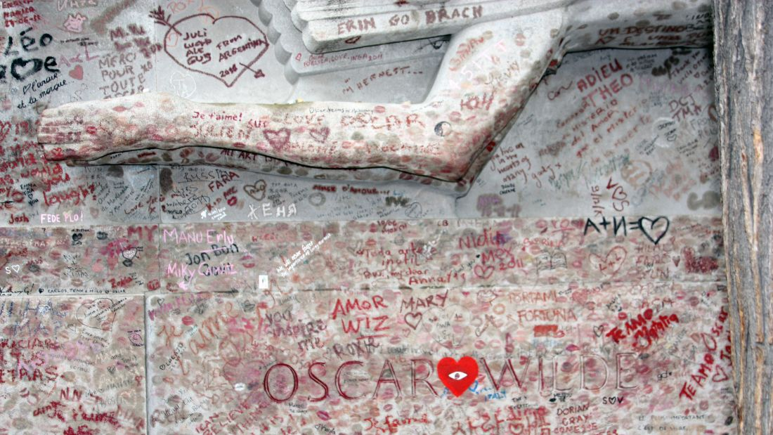 Kisses and graffiti left at Oscar Wilde's tomb in Paris