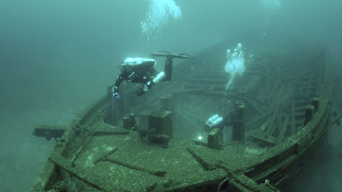 Maritime archaeologists survey the Rouse Simmons shipwreck on the bottom of Lake Michigan.