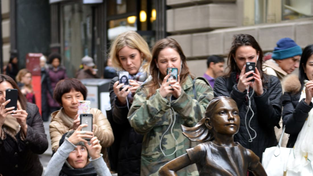 On March 7, 2017, a crowd gathered about the 'Fearless Girl' statue in New York City.