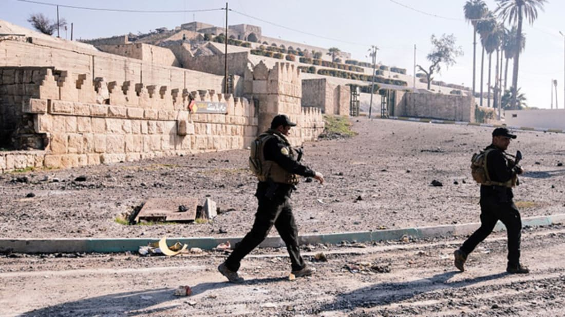 Iraqi forces patrol the front of the Nabi Yunus shrine in Mosul. Image credit: DIMITAR DILKOFF/Getty