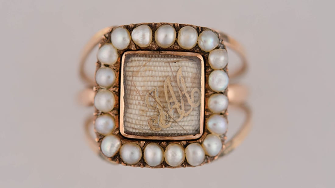 John and Abigail Adams Ring, American, 1812. Gold, pearls, crystal, gold foil, hair. Collection of the Massachusetts Historical Society