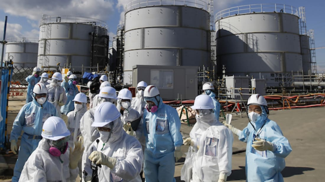TEPCO workers at the Fukushima plant // Getty Images
