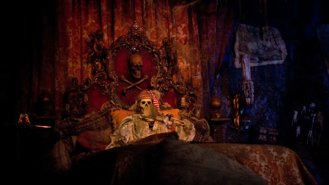 A fake skeleton, cozy in a bed decorated with an (allegedly) real skull. (Photo: Anna Fox/Flickr)