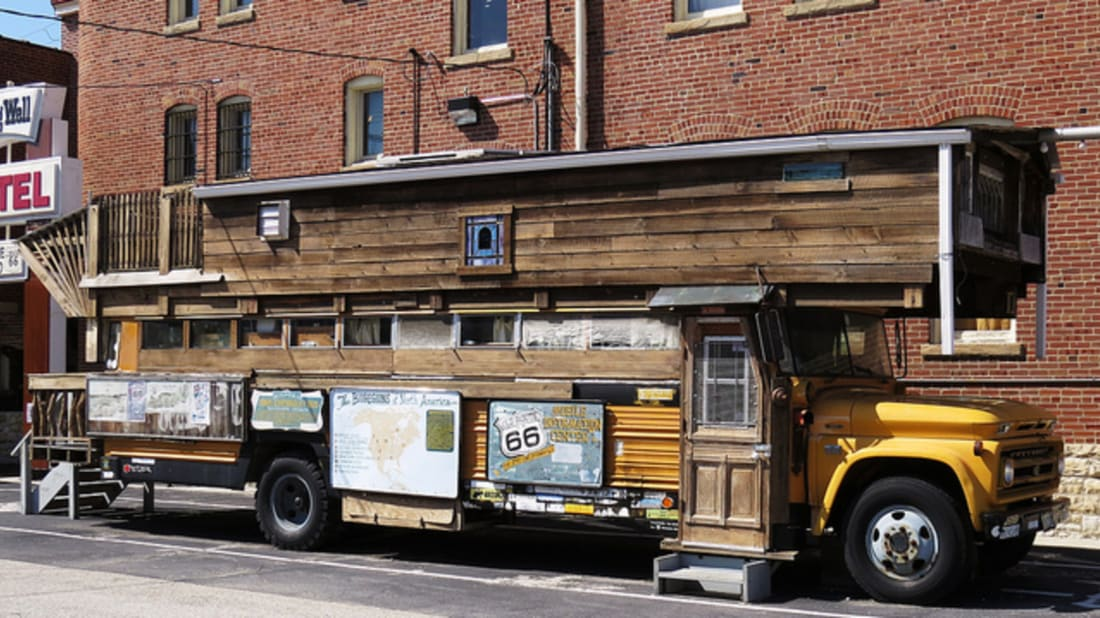 15 Creative Converted Buses | Mental Floss on bus with bullet holes, vw bus made into home, bus wheelchair inside, bluebird bus tiny home, school bus conversion into home, my bus home, hippie bus made into home, bus earrings, bus ride home,