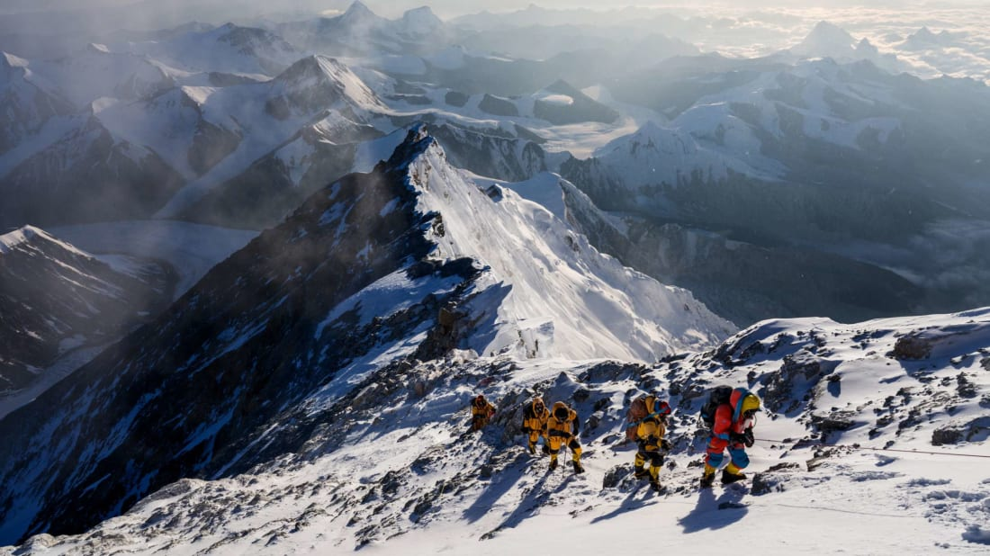 Team members climb up a slope during the expedition to find Sandy Irvine's remains on Mount Everest.