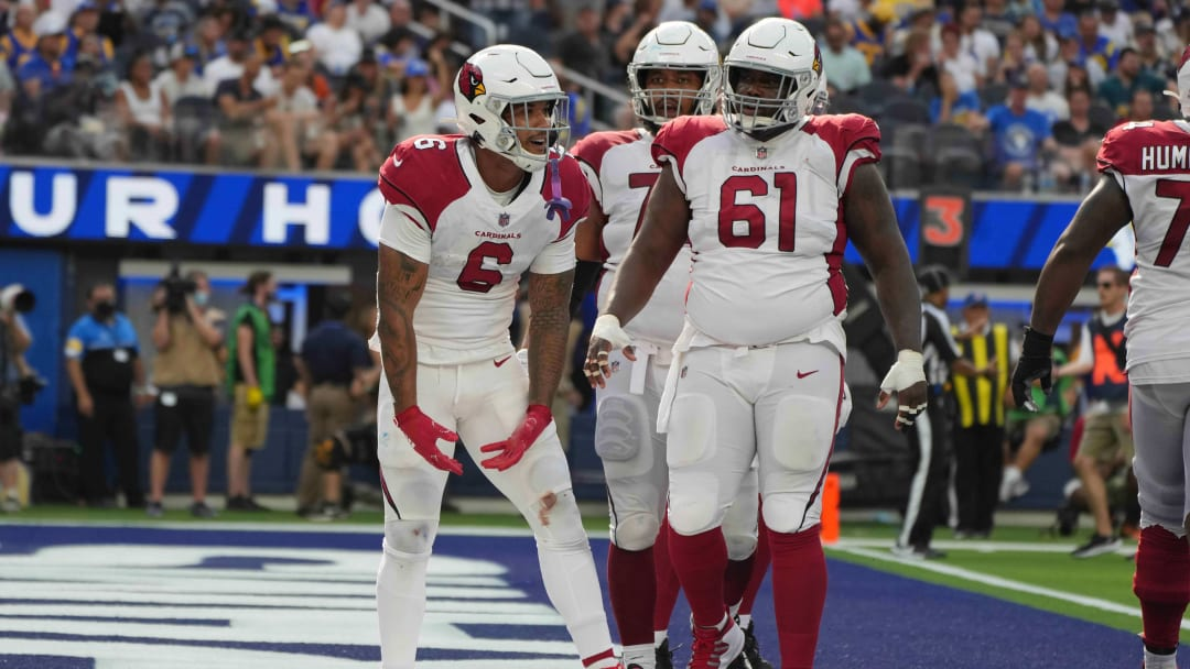 Cardinals player celebrate after a touchdown by James Conner (6) against the Los Angeles Rams at SoFi Stadium on Sunday.