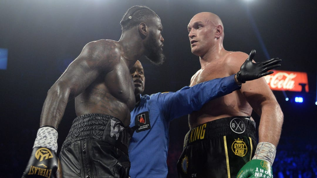 Feb 22, 2020; Las Vegas, NV; Deontay Wilder and Tyson Fury stare at one another during their WBC heavyweight title bout at MGM Grand Garden Arena.