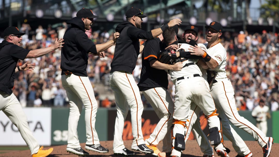 Giants players celebrate their 11-4 victory over the San Diego Padres at Oracle Park.