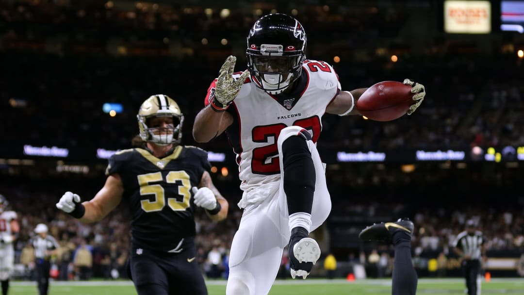 NEW ORLEANS, LOUISIANA - NOVEMBER 10: Brian Hill #23 of the Atlanta Falcons scores a touchdown as Eli Apple #25 of the New Orleans Saints and A.J. Klein #53 defends during the second half of a game at the Mercedes Benz Superdome on November 10, 2019 in New Orleans, Louisiana. (Photo by Jonathan Bachman/Getty Images)